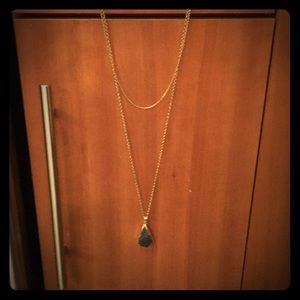 Gold necklace with black raw stone charm